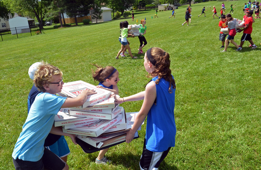 . Sixth graders move the boxes during Olympics Day activity at Hatfield Elementary School.   Friday, June 6, 2014.    Photo by Geoff Patton