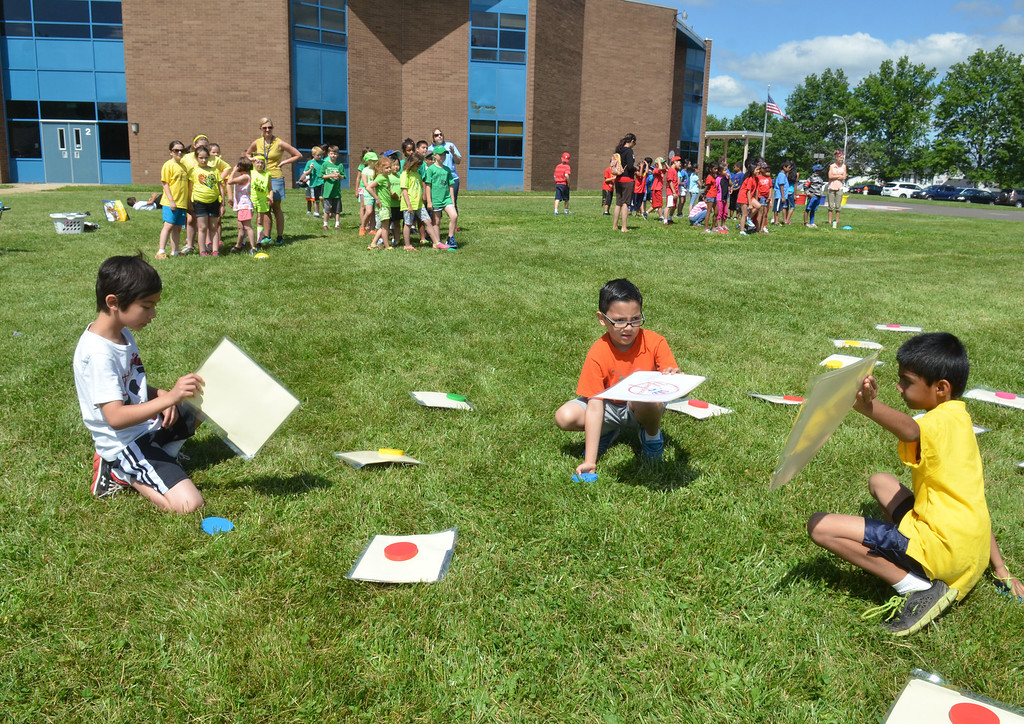. Students play a memory game on Olympics Day at Hatfield Elementary School.   Friday, June 6, 2014.   Photo by Geoff Patton