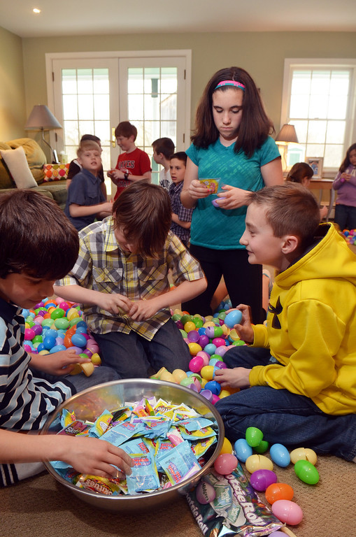 . Youngsters prepare eggs at Peter Zucca\'s home.  From left, Ethan Kanike, Tyler Currier, Lydia Vizza, and Connor Magee.  Friday, April 4, 2014.  Photo by Geoff Patton