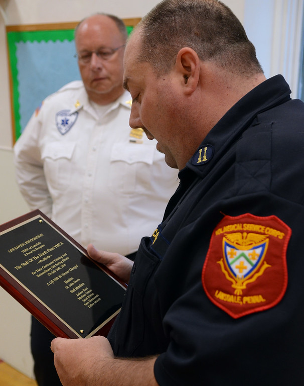 ". Volunteer Medical Service Corps of Lansdale Captain John Hanksworth (R0 and President Tim Duningan present a ""Life Saving Recognition Award to North Penn YMCA staff for their recent emergency medical response to an incident at the YMCA. Thursday August 21,2014. Photo by Mark C Psoras/The Reporter"