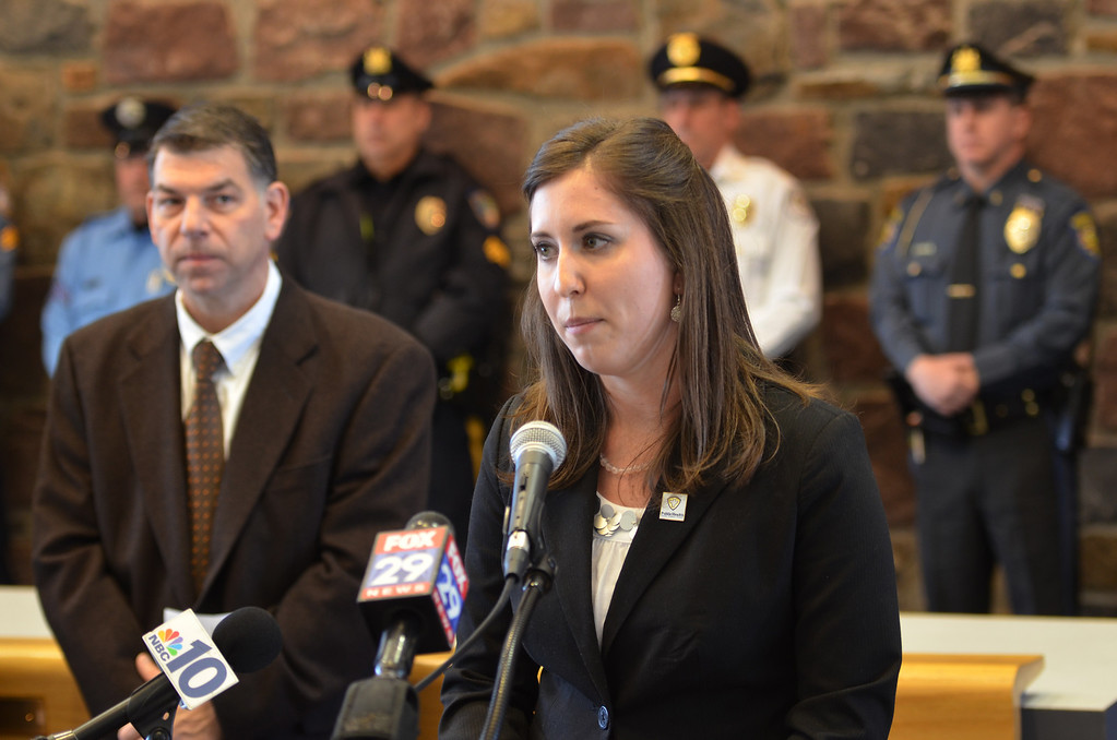 . Katie Kucz from the Montgomery Clounty Health Department speaks at a news conference held to kick off  a statewide aggressive-driving campaign that runs from March 24 through May 4, and will target motorists exhibiting aggressive-driving behaviors such as running red lights, speeding and tailgating.  At left is Gordon Beck from Buckle Up Pa, and second from left is Montgomery Township police chief Scott Bendig.    Monday,  March 24, 2014.   Photo by Geoff Patton