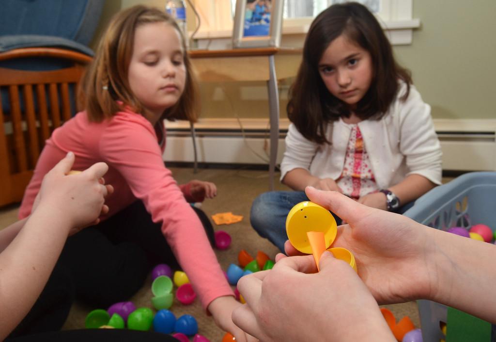 . Bridget Magee, left, and Julia Vizza help prepare fopr Joni & Friends Easter Egg Hunt.   Friday, April 4, 2014.  Photo by Geoff Patton