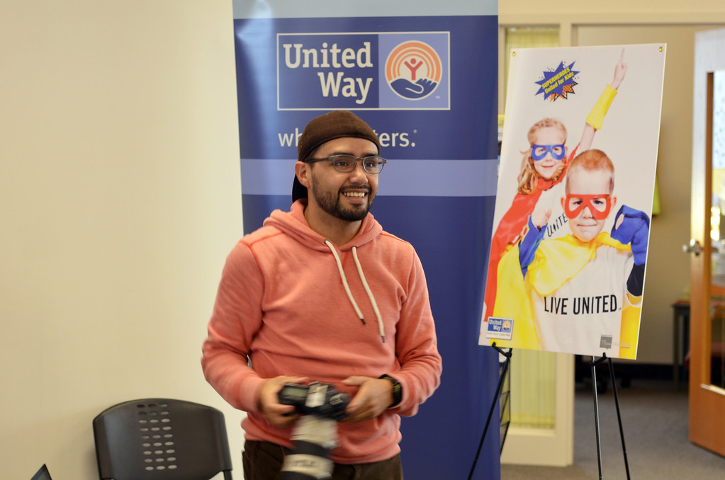. Photographer Marco Calderon at work  during a shoot for the North Penn United Way\'s third annual Superheroes United for Kids event.   Finished photographs are used in promotion and will be  displayed during the event in April.   Friday, January 24, 2014.  Photo by Geoff Patton