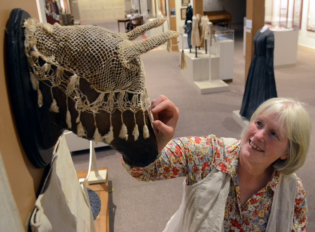 . Mennonite Heritage Center Director Sarah Heffner explains a cotton horse veil or netting ,circa 1895, displayed in the Common Threads exhibit (textiles from the Mennonite Heritage Center,Goschenhoppen Historians, and the Schwenkfelder Library & Heritage Center)Photo by Mark C Psoras/The Reporter