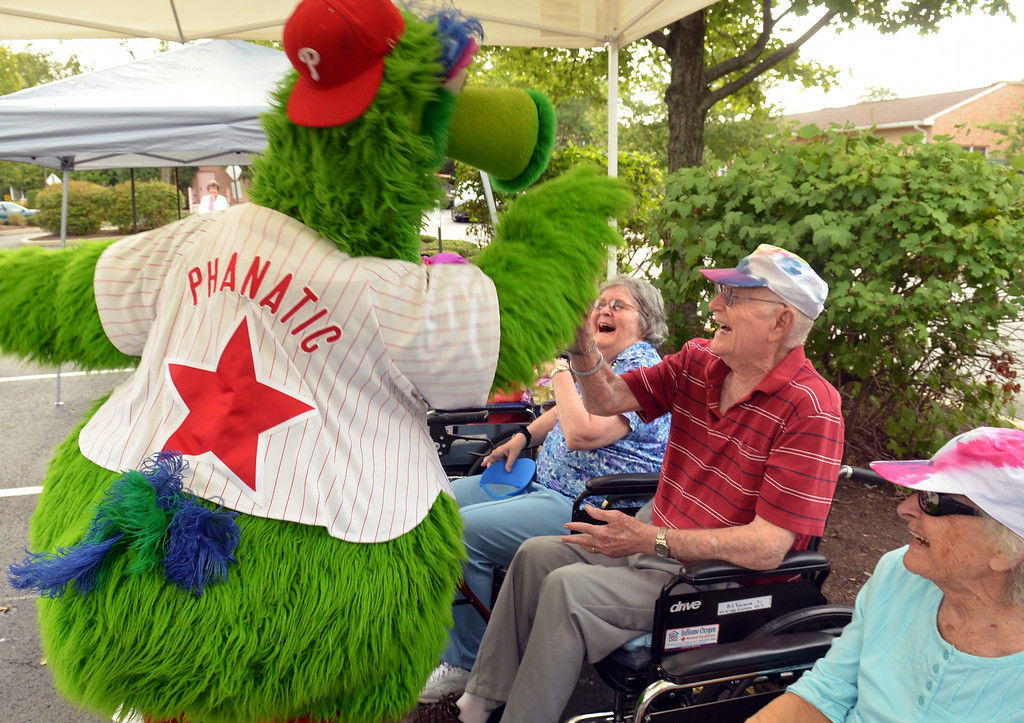 . The Philly  Phanatic delivers high-fives on his  visit to the Fifth Annual Senior Olympics held at Dock Terrace in Towamencin.   The Phanatic also made a guest appearance as a pitcher and cheeleader during the residents\' baseball game.  Youngsters from nearby Salford Mennonite Childcare Center also joined the game.