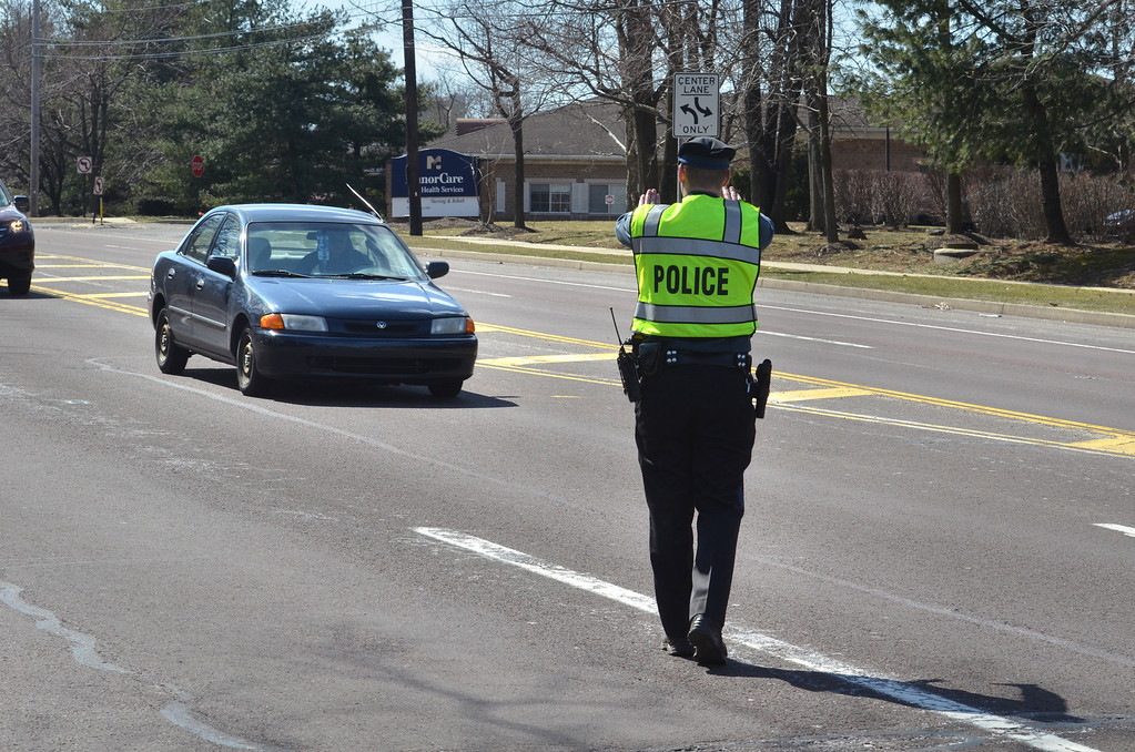 . A Montgomery Township police officer  stops a motorist for speeding  on Bethlehem Pike on the first day of  off a statewide aggressive-driving campaign that runs through May 4, and will target motorists exhibiting aggressive-driving behaviors such as running red lights, speeding and tailgating.  Monday, March 24, 2014.   Photo by Geoff Patton