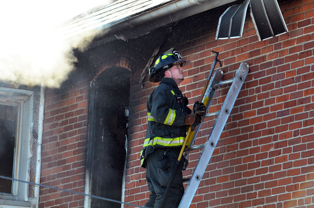 . Firefighter at scene of house fire on Forty Foot Road in Hatfield Township.   Thursday, Janury 23, 2014.  Photo by Geoff Patton