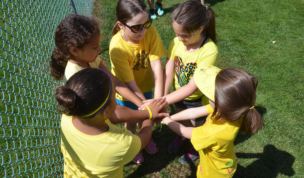 . Second grade teammates bond during  Olympics Day at Hatfield Elementary School.   Friday,  June 6, 2014.   Photo by Geoff Patton