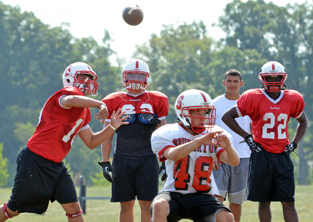 . Souderton Area player Joe Curotto throws a pass during morning practice.   Monday,  August 11, 2014.   Photo by Geoff Patton