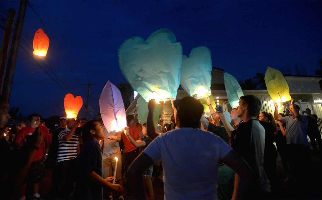 . Friends of the victim of a fatal crash on Broad St., Hatfield release hot air balloons at a vigil Monday night, Aug. 25, 2014. Montgomery Media staff photo by Bob Raines