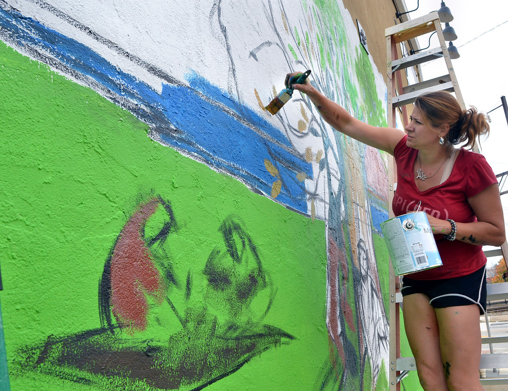 """. Artist Karin Wolfe Hendricks works on her piece titled \""""Seasons\"""" on the wall of Wes Carver Electrical Contracting,Inc. as part of the Lansdale Business Associations Mural Arts Program on Thursday October 3,2013. Photo by Mark C Psoras/The Reporter"""