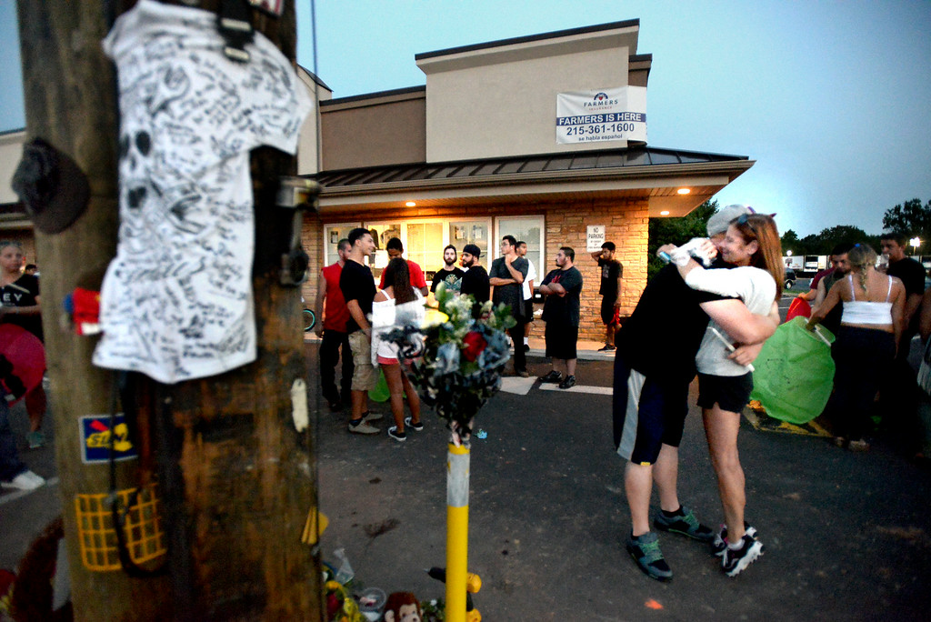 . Mourners gather Monday, Aug. 25, 2014 at the site of a fatal accident along Broad St., Hatfield. Montgomery Media staff photo by Bob Raines